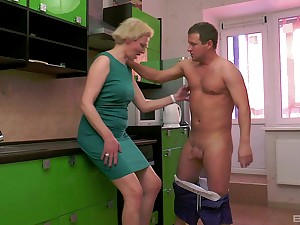 Mature short haired tow-haired wife Elena pussy pounded in the kitchen