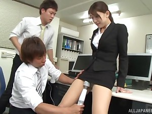 Japanese babe fucked and edibles cum off of two cocks in the office
