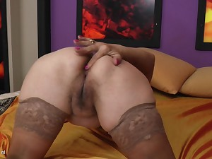 Solo action with mature Sabreena pleasing herself in stockings