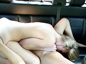 Two sweet girls appreciate sensual lesbian lovemaking in car
