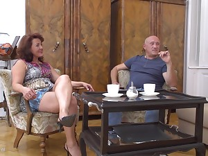 Buxom redhead mature MILF Isadora M. takes a hard cock doggy style