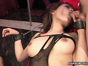 Bushy pussy of handcuffed Asian slut Yui Shimizu is teased hither sex toys
