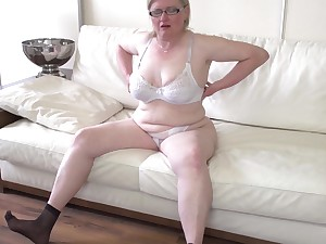 Mature amateur blonde BBW Jaroline K. fingers the brush asshole