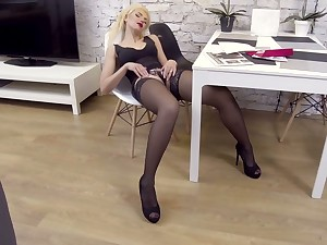 Long legged auburn MILF Zara loves petting herself in excess of the chair