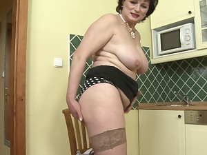 Mature Dalia plays with their way pussy and their way favorite dildo in their way kitchen