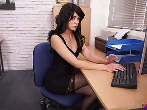Raven haired office clerk Tracy Rose flashes tits and wanks a fake cock