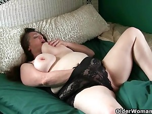 Large-Breasted granny takes care of her pain clit