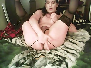 Schoolgirl tranny rides her dildo